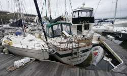 Storm damaged boats sit at the dock in a marina, Thursday, Sept. 17, 2020, in Pensacola, Fla. River