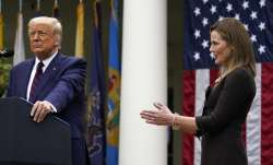 Judge Amy Coney Barrett applauds as President Donald Trump announces Barrett as his nominee to the