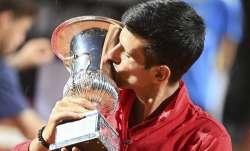 Serbia's Novak Đjoković kisses his trophy after winning