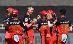 RCB pacer Chris Morris (centre) celebrates after picking up a RR wicket in Sharjah.