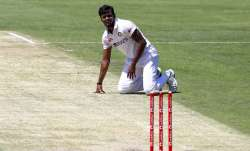 India's Thangarasu Natarajan falls onto the pitch during