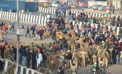Farmers break the police barricades at the Ghazipur border as move towards Akshardham during their t