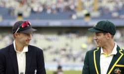Joe Root of England and Tim Paine of Australia meet for the
