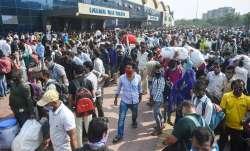 Mumbai: Passengers rush outside Lokmanya Tilak Terminus to
