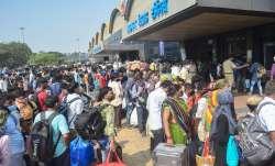 Passengers stand outside the Lokmanya Tilak Terminus to