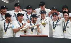 New Zealand players celebrate with the winners trophy after their win in the World Test Championship