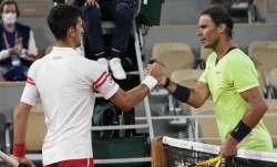Serbia's Novak Djokovic, left, shakes hands with Spain's