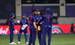 India skipper Virat Kohli in conversation with Jasprit Bumrah and KL Rahul during their clash agains