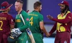 West Indies' Shimron Hetmyer, left, congratulates South Africa's Rassie van der Dussen as West Indie