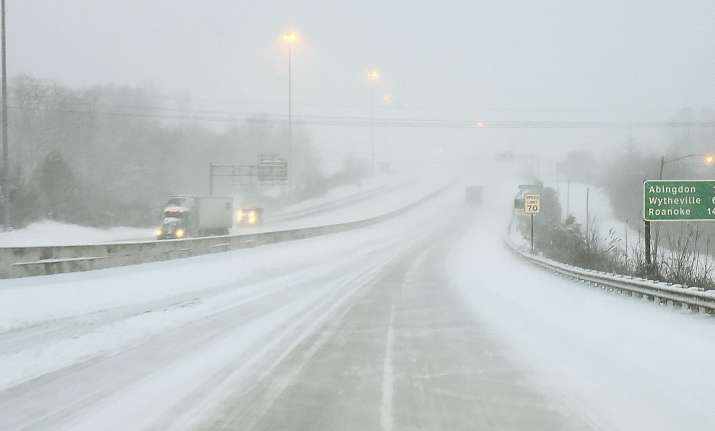 Accidents on snow-covered interstates caused major delays,