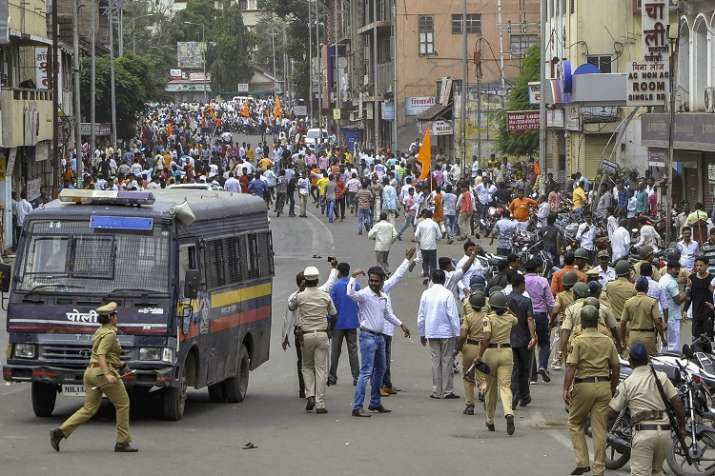 Police personnel clash with the Maratha Kranti Morcha