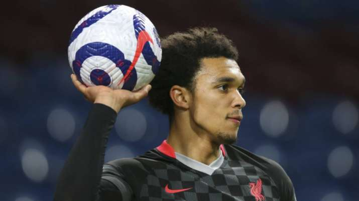 Liverpool's Trent Alexander-Arnold holds up the ball during