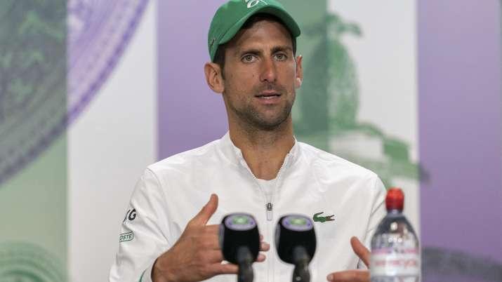 Novak Djokovic attends a press conference after winning the